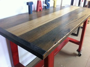 Red Metal Island Bench with Blackbutt Top - Close Up