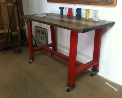 Red Metal Island Bench with Blackbutt Top on Castors