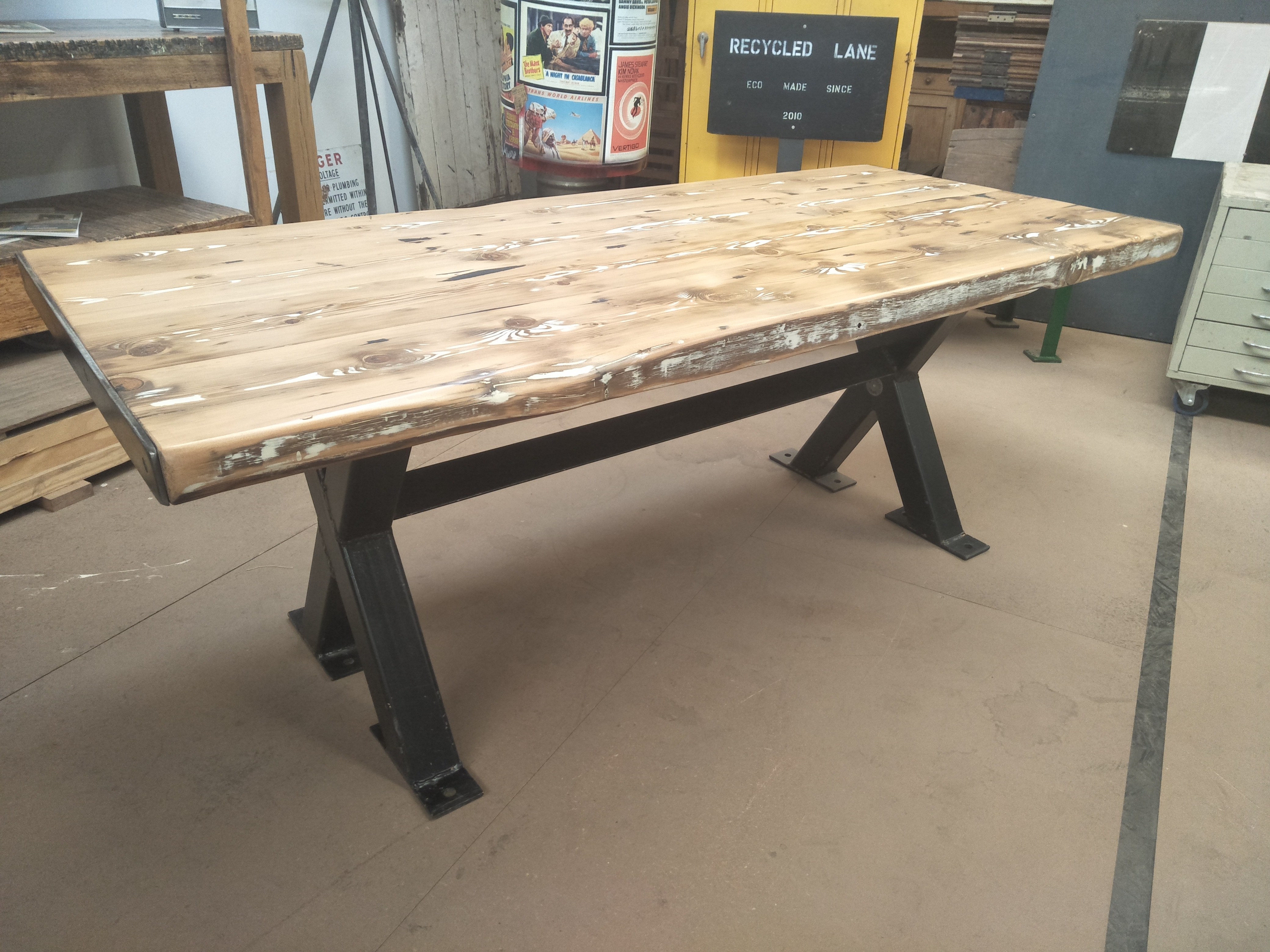 Black metal frame table with recycled oregon top